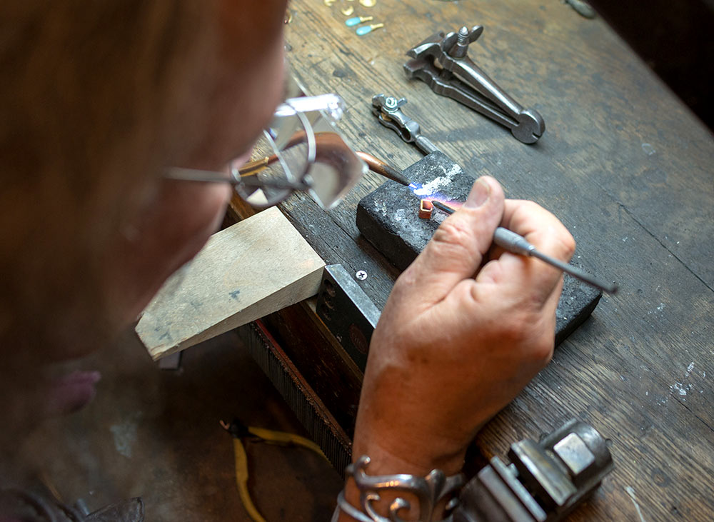 Mark Howard working on a ring at his jewelry design studio in Santa Fe