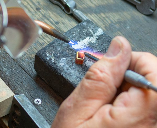 Close-up of Marc Howard working on a piece of custom jewelry in Santa Fe, NM