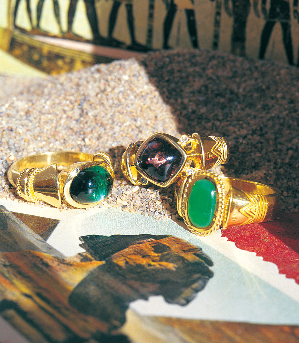 An selection of Egyptian-inspired gold rings at Marc Howard Custom Jewelry Design in Santa Fe, NM
