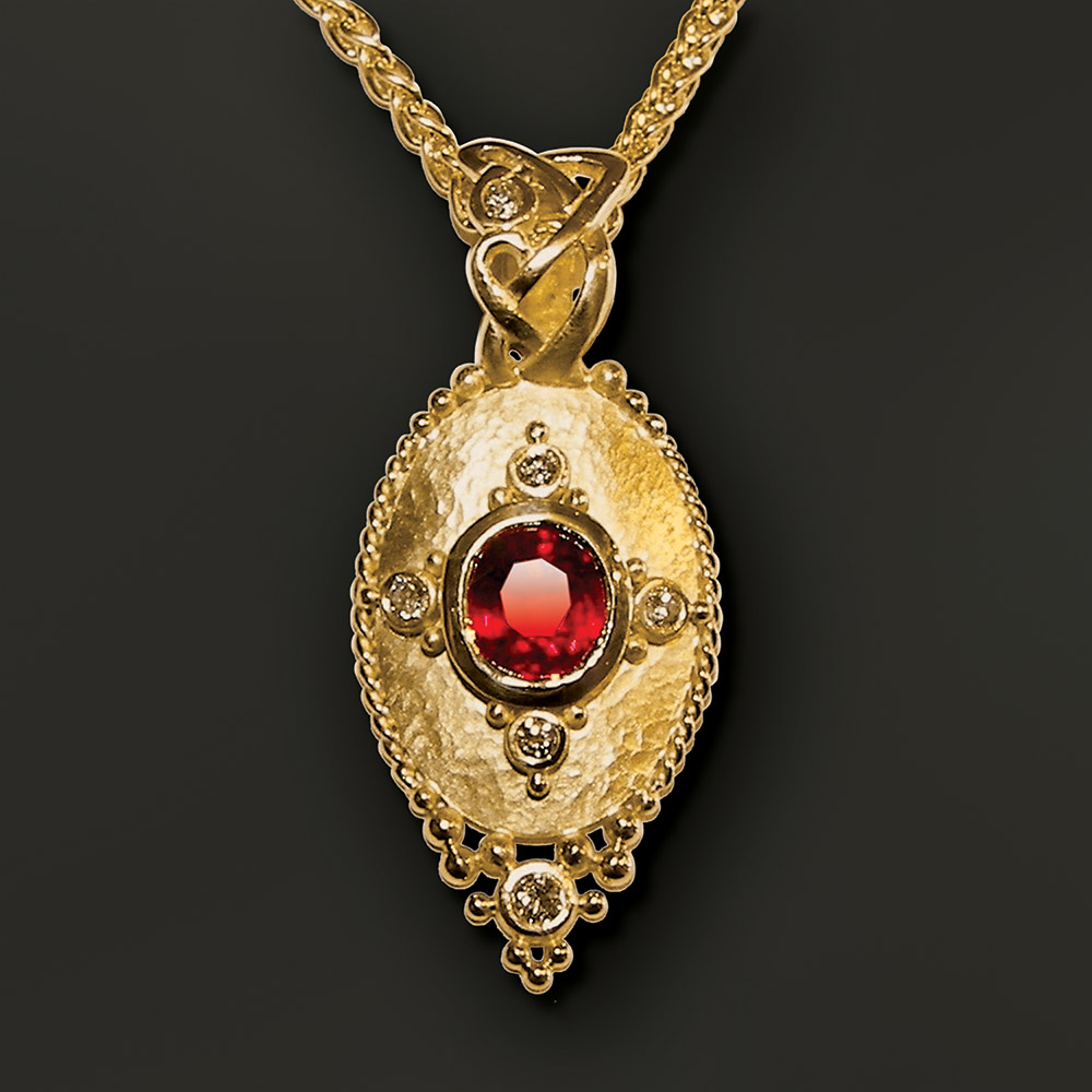 Elegant gold pendant at Marc Howard Custom Jewelry Design studio in Santa Fe, New Mexico