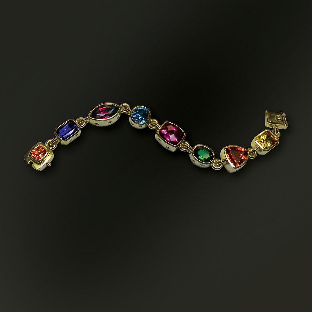 Colorful multi-gem bracelet at Marc Howard Custom Jewelry Design studio in Santa Fe, New Mexico