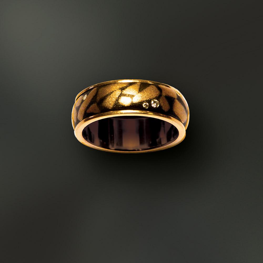 Photo of custom-designed gold ring at Marc Howard Custom Jewelry Design studio