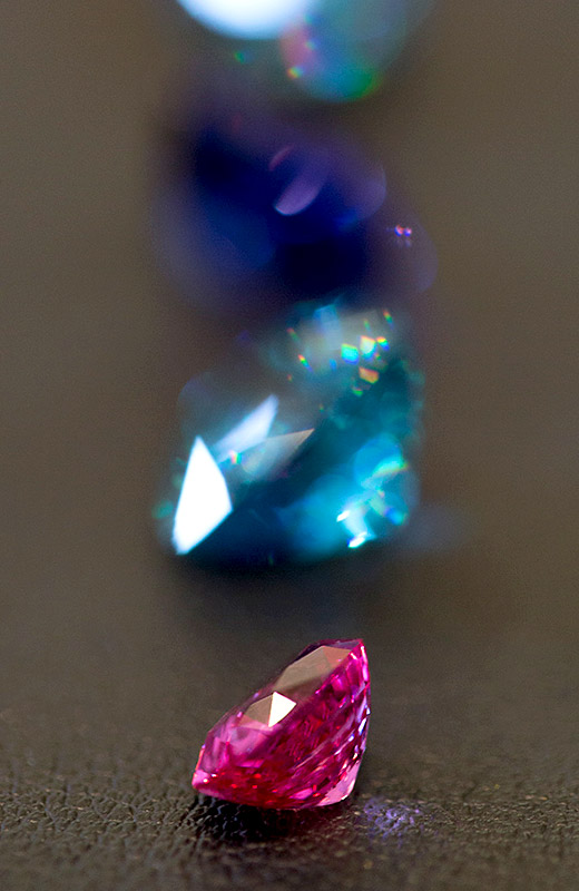 Close-up of gems to be used in custom jewelry designed by Marc Howard in Santa Fe, NM