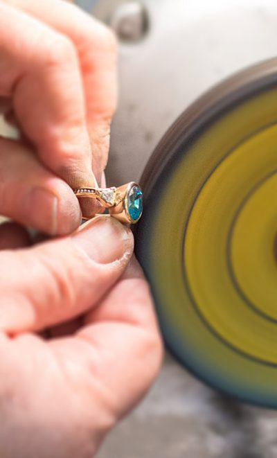 Mark Howard polishing a ring in his design studio in Santa Fe, New Mexico