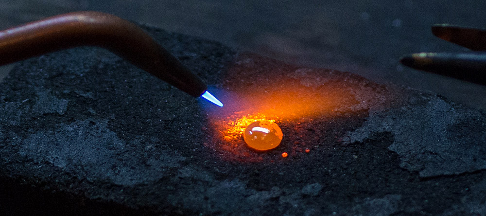 A molten gem being heated at Marc Howard Custom Jewelry Design in Santa Fe, NM