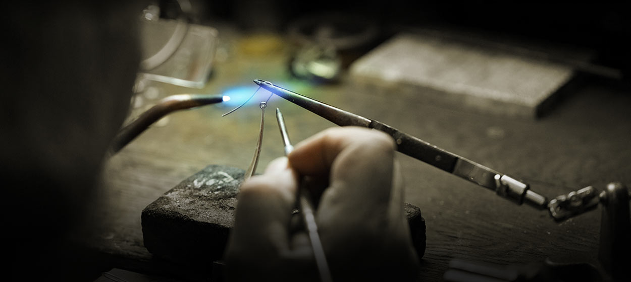 Mark Howard, jewelry designer, working on an earring at his design studio in Santa Fe, New Mexico