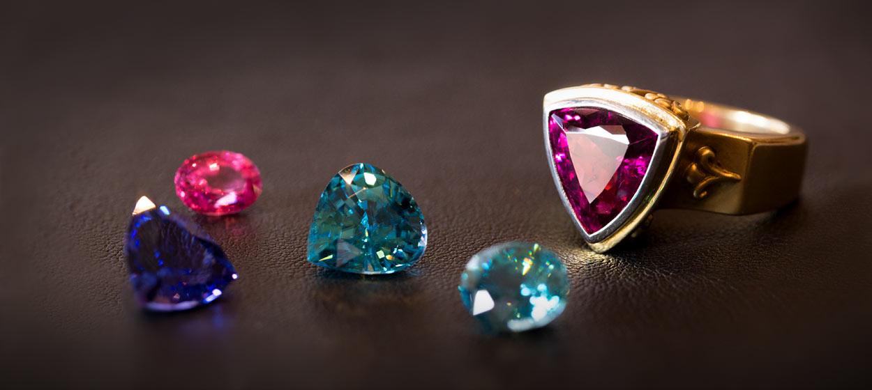 Photo of custom designed gold ring with gemstones at Marc Howard Custom Jewelry Design, Santa Fe, NM