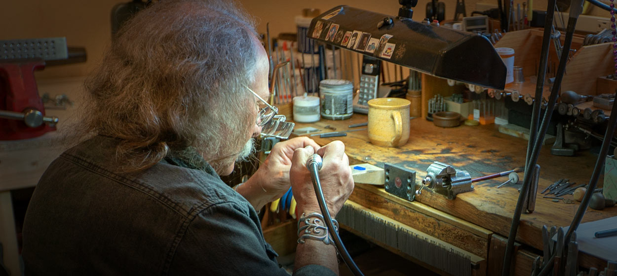 Mark Howard, Goldsmith working on a piece of jewelry at his design studio in Santa Fe, NM